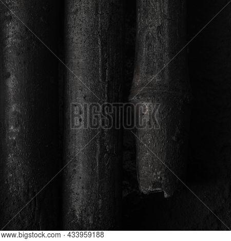 Bamboo Charcoal  Sticks On Coal Powder Black Background. Powerful Water Purifier