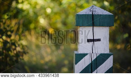 Quarterly Pillar In The Forest. A Wooden Pillar For A Landmark In The Forest. Forestry Post. Wood Po