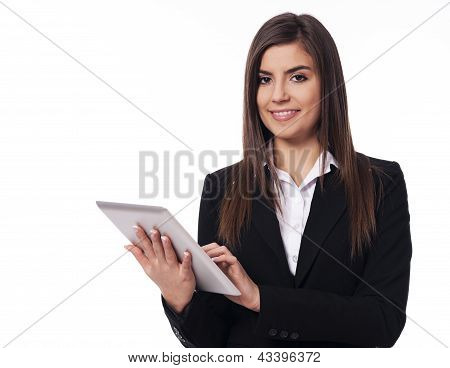 Happy business woman using digital tablet