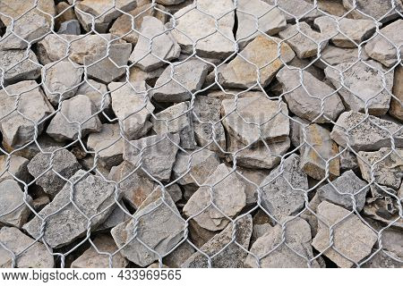 Gabions Protective Wall Filled With Stones And Tied With Thick Metal Wire. Metal Cages Filled With R