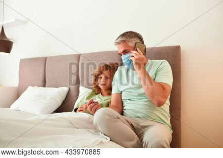 Portrait Of Caring Dad In Facemask Call Ambulance For Sick Teen Son Have Flu Fever. Father Make Ask