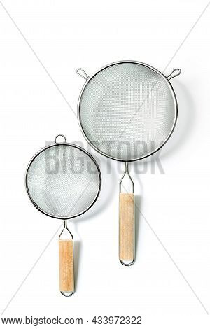 Two Fine Mesh Strainers - Large And Small. Silver Colored Metalic Colanders With Wooden Handle Isola