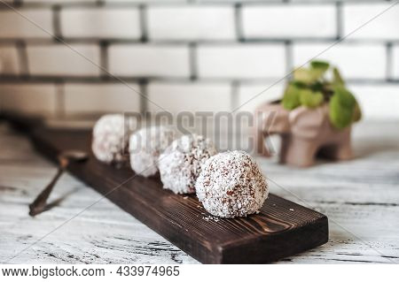 Homemade Truffle Candies In Coconut Flakes Close-up And Copy Space.