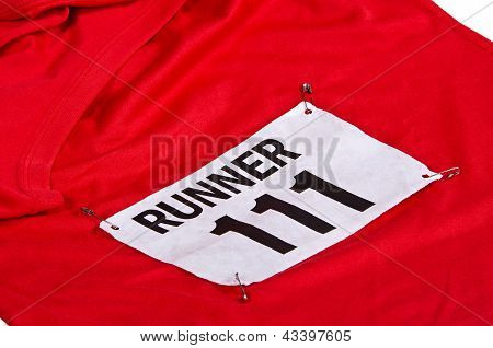 Race number on running shirt