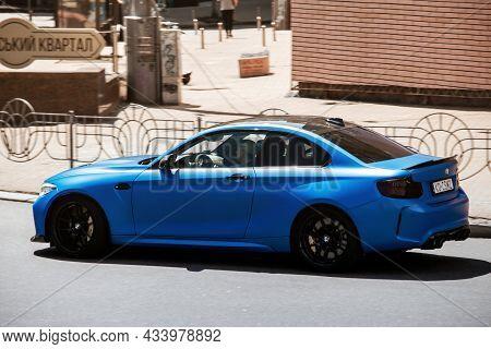 Kiev, Ukraine - June 12, 2021: New Bmw M2 Cs Coupe In Motion. Blue Bmw M2 Cs In The City