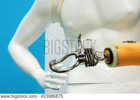 Worker Prosthetic Arm On A Plastic Mannequin. Demonstration Of A Modern Product Of High Quality. Ten