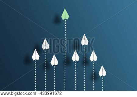 Paper Planes Flying In Formation In One Direction On Blue Background And One Paper Glider Flying Ahe