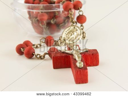 Red color cross with red chaine