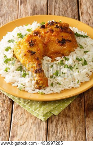 Ayam Percik Coconut Spiced Chicken With Rice Close Up In The Plate On The Table. Vertical