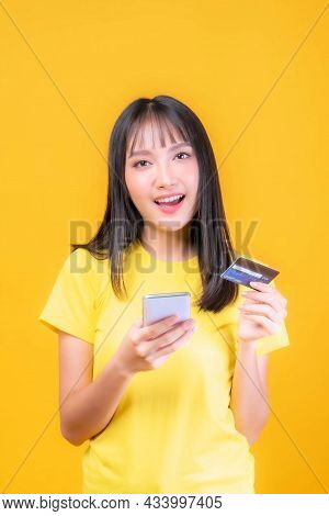 Beautiful Asian Young Woman Cute Girl With Bangs Hair Style In Yellow Shirt Holding Credit Card And