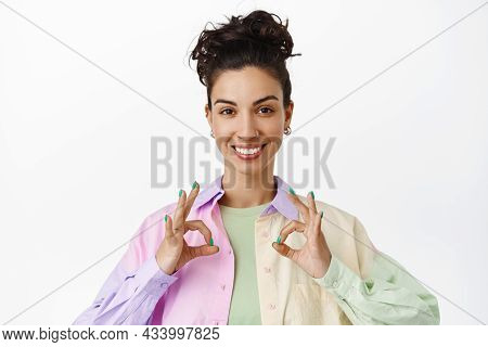 Very Good. Smiling Brunette Woman Shows Ok Okay Hand Sign And Looking Satisfied, Recommend Great Dea