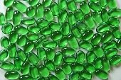 Small smooth green glass pebbles texture of various sizes poster