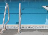 calm empty blue pool and silver ladder poster
