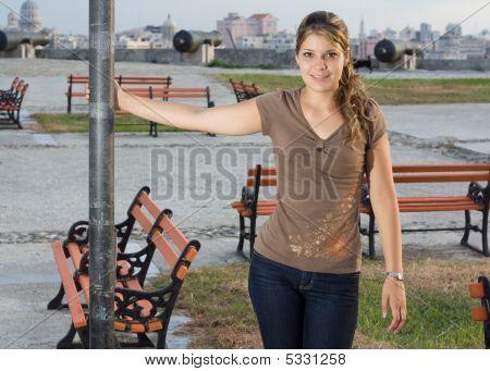Girl Standing Beside An Iron Column