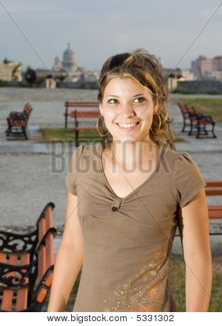 Girl Smiling In A Park, With Havana City Background