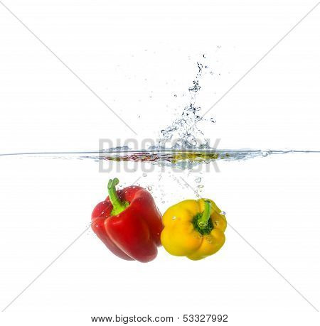 Two Fresh Red And Yellow Paprika Splash In Water