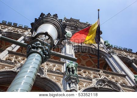 Belgium flag on Grand Place in Brussels poster