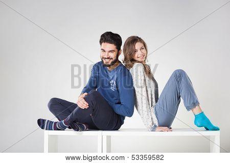 Happy Couple In Pyjama Posing In The Studio