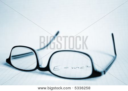 Glasses And Paper With E=mc2