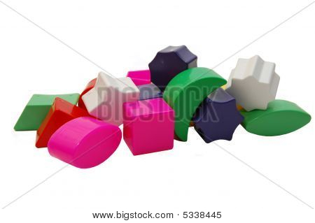 Plastic multi-coloured geometrical figures on a white background poster