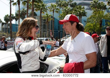 LOS ANGELES - APR 12:  Tricia Helfer, Michael Trucco at the Long Beach Grand Prix Pro/Celeb Race Day at the Long Beach Grand Prix Race Circuit on April 12, 2014 in Long Beach, CA