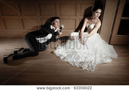 Woman  photographer taking a picture of bride