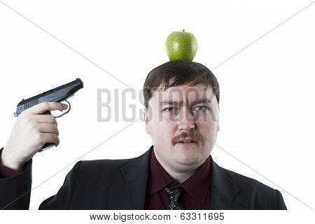 Man Aims At The Apple On His Head