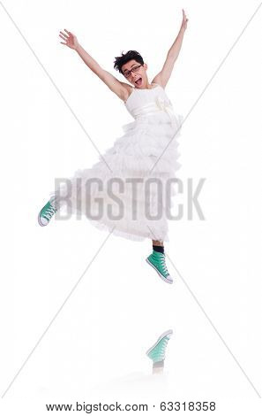 Funny dancing  man wearing in woman dress isolated on white