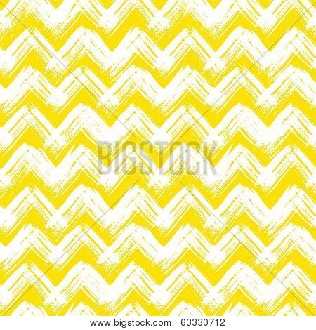 Vector seamless chevron pattern hand painted with bold brushstrokes in bright yellow can be used for print, wallpaper, fall summer fashion, and gift wrapping paper poster