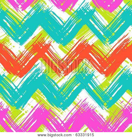 Vector seamless chevron pattern hand painted with bold brushstrokes in bright multiple colors can be used for print, wallpaper, fall summer fashion, fabric, textile, gift wrapping paper, home decor poster