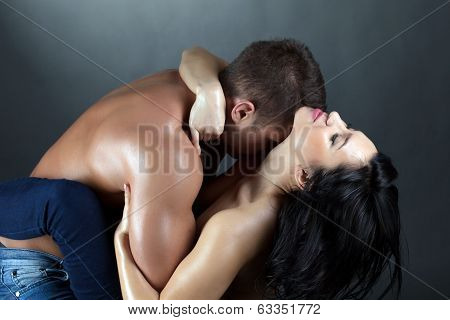 Portrait of passionate topless partners embracing, close-up poster