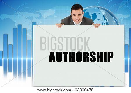 Businessman showing card saying authorship against digital background
