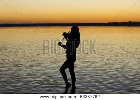 Violinist on the lake