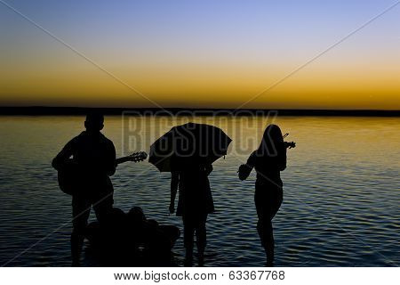 Musicians on the lake