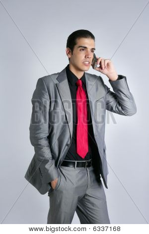 Businessman In Gray Suit Holding Laptop