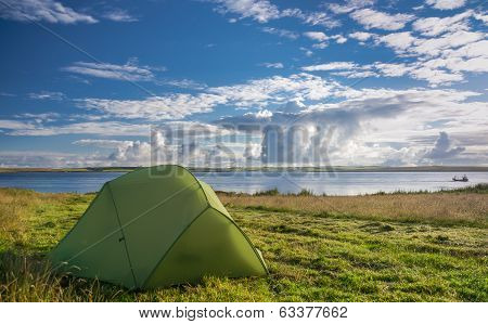 Pitched Tent Near Lake On Sunny Day