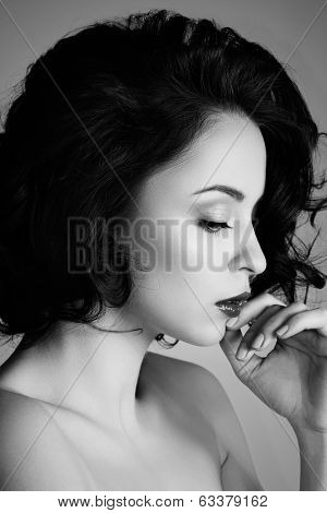 Closeup side view of young beautiful thoughtful woman