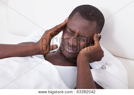 Young Man Having Headache