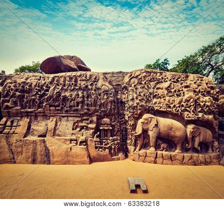 Vintage retro hipster style travel image of Descent of the Ganges and Arjuna's Penance ancient stone sculpture - monument at Mahabalipuram, Tamil Nadu, India