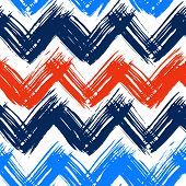 Vector seamless chevron pattern hand painted with bold brushstrokes in bright nautical colors can be used for print, wallpaper, fall summer fashion, and gift wrapping paper poster