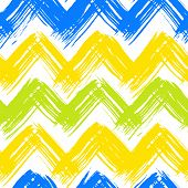 Vector seamless chevron pattern hand painted with bold brushstrokes in bright multiple colors can be used for print, wallpaper, spring summer fashion, fabric, textile, gift wrapping paper, home decor poster