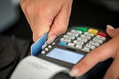 Debit card swiping on pos terminal poster