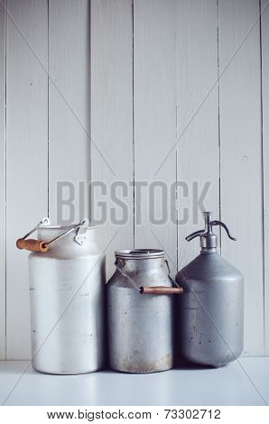 Milk Cans And A Siphon