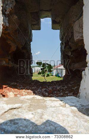 The loophole in the wall St. Nikolo-Tikhonov monastery.