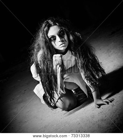 Horror Shot: Scary Monster Girl With Knife In Hands. Black And White