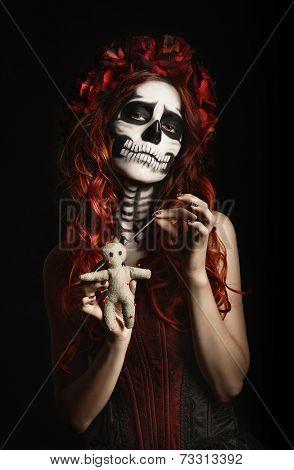 Young Woman With Calavera Makeup (sugar Skull) Piercing Voodoo Doll