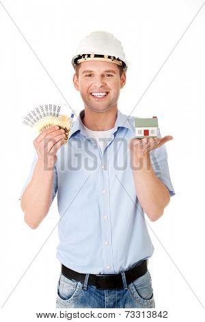 Construction man holding house model and money.