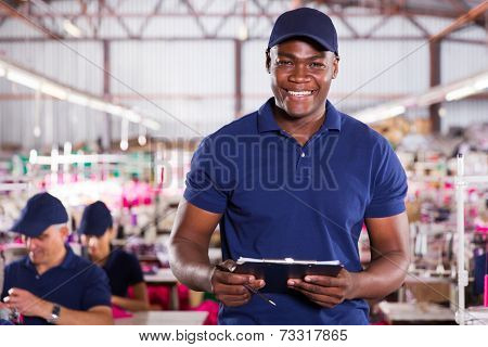 handsome african american textile worker holding a clipboard