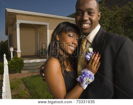 African couple hugging