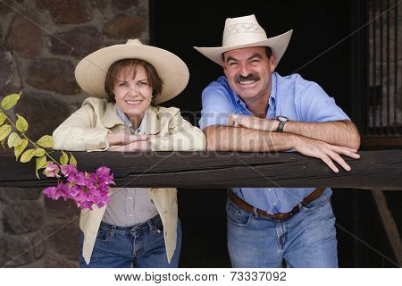 Hispanic couple wearing cowboy hats
